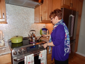 Rosanne preparing a new recipe of sautéed bay scallops.