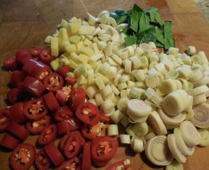 Chopped Thai peppers, garlic, ginger, kaffir lime leaves and lemongrass.