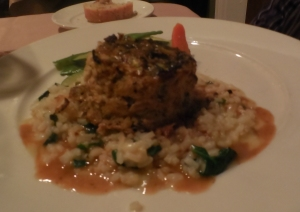 Zucchini Crusted Crab Cake with spinach risotto and a citrus sage berre blanc.
