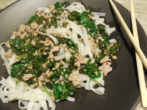 Dish of the Asian Pork with Spinach.