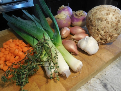 "Most of the raw ingredients before chopping. That lovely brown ""brain"" looking thing on the right is a celery root."