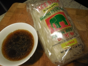 Package of Asian rice noodles and the premixed sauce.