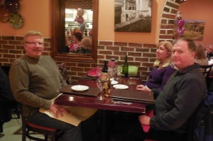 Russ with good friends Barb Walsh and Brad Collins eagerly awaiting our pizza orders.