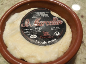 Small crock of saint-marcellin cheese.