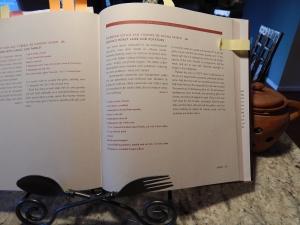 Penelope Casas' La Cocina de Mamá book open to the roasted lamb recipe.