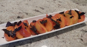 Heirloom tomato from Shady Brook Farms with fresh purple basil from our garden.