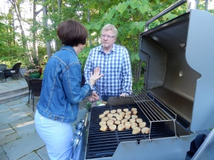 Karen and Russ discussing the merits of grilling the baguette rounds.